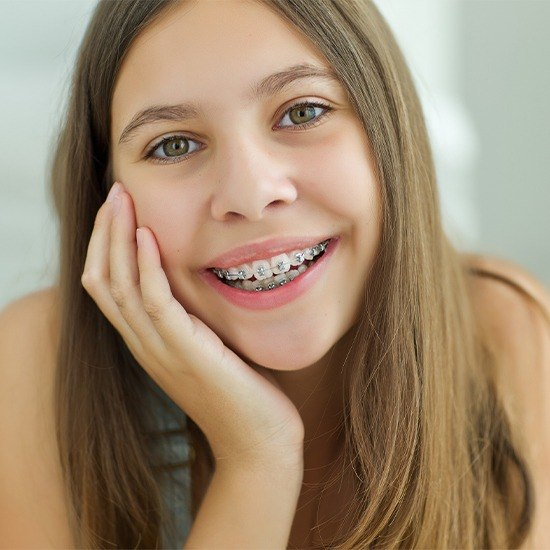 Teen girl with self-ligating braces smiling