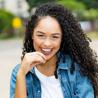 Young woman with metal braces smiling