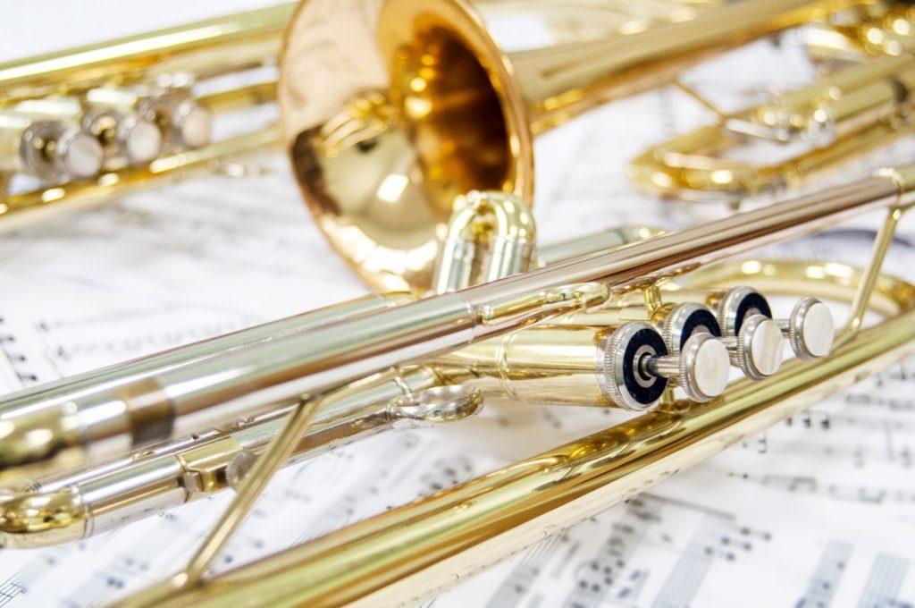 Closeup of golden trumpet lying on sheet music